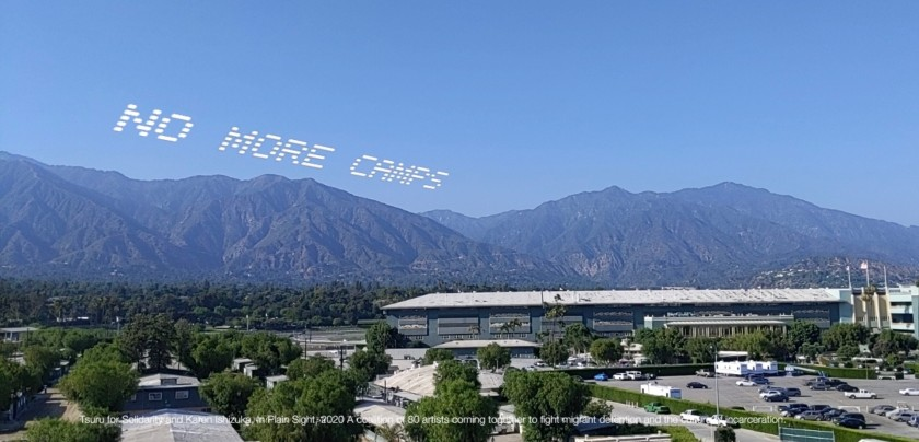 """An augmented reality visualization shows the words """"NO MORE CAMPS"""" over Santa Anita Park."""