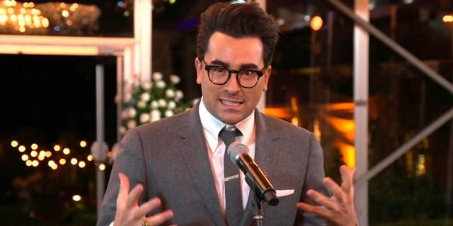 """In this video grab captured on Sept. 20, 2020, courtesy of the Academy of Television Arts & Sciences and ABC Entertainment, Daniel Levy accepts the award for outstanding writing for a comedy series for """"Schitt's Creek"""" during the 72nd Emmy Awards broadcast."""