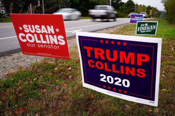 """A """"Trump Collins 2020"""" sign, right, paid for by the Maine Democratic Party, stands alongside a """"Susan Collins our senator"""" sign, paid for by the Maine Republican Party in Freeport, Maine."""