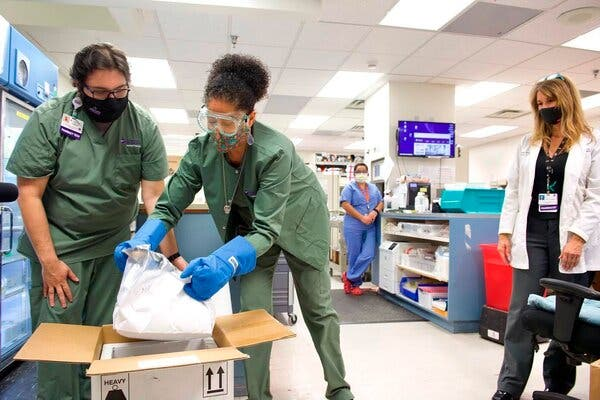 Pharmacy workers unpacked the first shipment of vaccine at the Christus St. Vincent Regional Medical Center in Santa Fe, N.M., on Monday.
