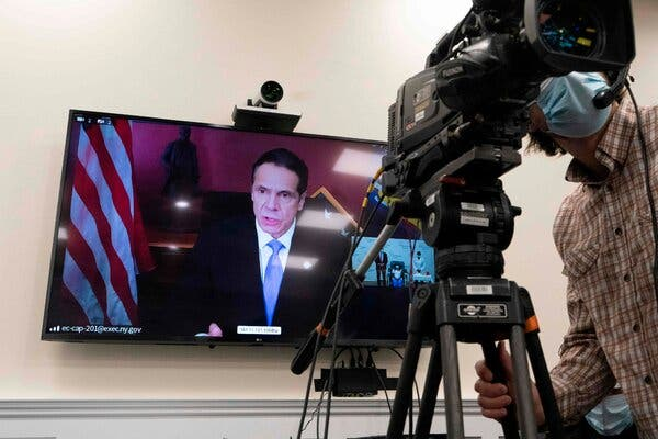 Gov. Andrew M. Cuomo of New York on Monday. A healthcare worker in Queens was vaccinated at Long Island Jewish Medical Center in Queens on Monday.