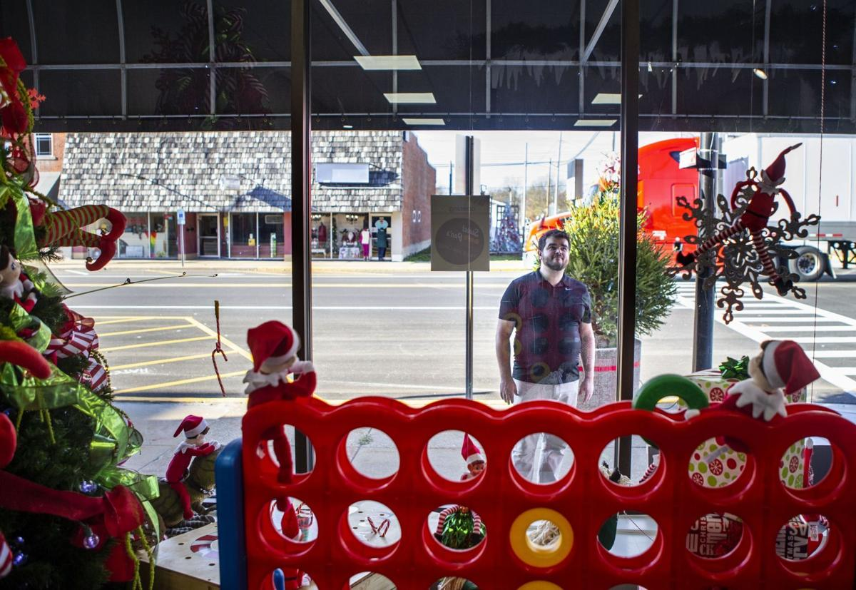Decorating windows for Christmas in Jerseyville