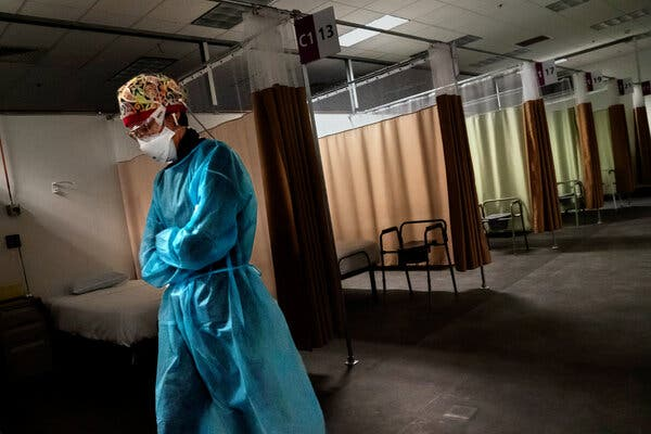 Patricia Carrete, a nurse, during a night shift at a field hospital in Cranston, R.I., this month.