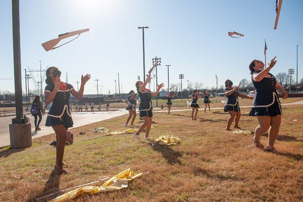 Color guard participants practice their routine at a competition in Southaven, Miss., on Saturday after Gov. Tate Reeves ended the statewide mask mandate early last week.