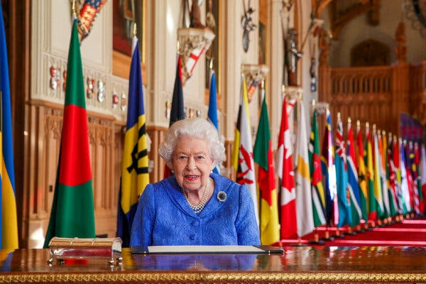 Queen Elizabeth II signs her annual Commonwealth Day Message in St. George's Hall at Windsor Castle.