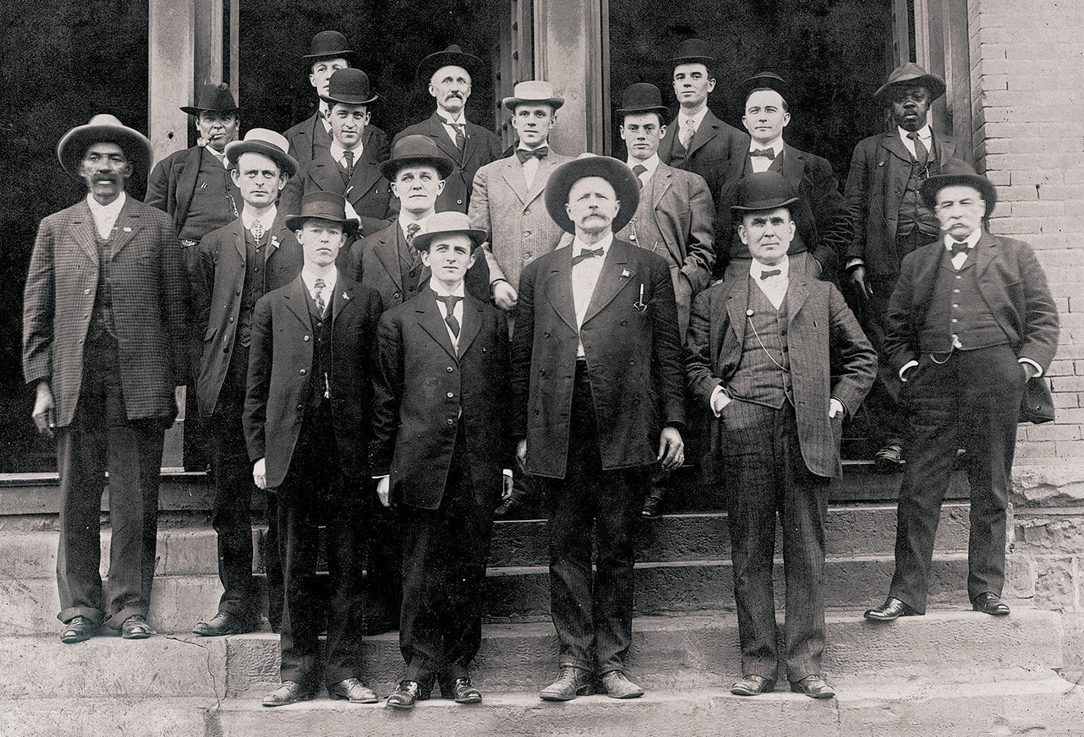 Reeves (far left), at age 69, posing with fellow members of the U.S. Marshals Service on the first day of Oklahoma statehood, November 16, 1907.